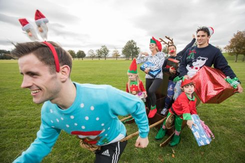 One month to go to register for the Aware Christmas Run. Conor Walsh (pulling the sleigh) with Leinster rugby player Joey Carbery; presenter Cassie Stokes; blogger Rosemary McCabe; and elves Ryleigh Brady and Matthew Hannon who are reminding people to register the 12th annual Aware Christmas Run.