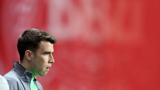 Seamus Coleman watches training. Photograph: Ryan Byrne/Inpho