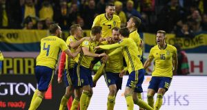 Swedish players celebrate Jakob Johansson's goal in the World Cup playoff first leg match against Italy at   Friends Arena  in Solna, Sweden. Photograph: Claudio Villa/Getty Images