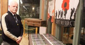 Tom Burnell with all 15 volumes of his series 26 County Casualties of the Great War at the Castlecomer Discovery Park in Kilkenny recently. Photograph: Ronan McGreevy