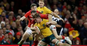 Australia's Michael Hooper scores his side's third  try in the match against Wales at  the Principality Stadium in Cardiff. Photograph: Paul Childs/Action Images via Reuters