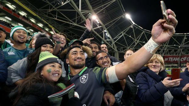 Bundee Aki takes a selfie with his family after the match. Photograph: Dan Sheridan/Inpho
