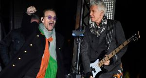 Bono  and Adam Clayton of  U2 perform with the band  in Trafalgar Square in central London  during the MTV Presents Trafalgar Square event ahead of the MTV Europe Music Awards  tomorrow. Photograph: Chris J Ratcliffe/AFP/Getty Images