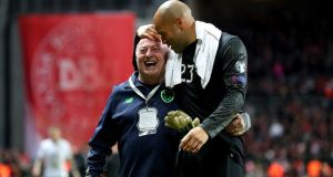 Republic of Ireland goalkeeper  Darren Randolph with kit man Dick Redmond after the  World Cup playoff first leg against Denmark at the the Parken stadium. Photograph: James Crombie/Inpho