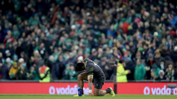 Bundee Aki takes a moment to himself after the game. Photograph: Dan Sheridan/Inpho
