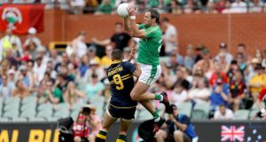 Ireland's Michael Murphy gets above  Shaun Burgoyne of Australia to take the ball during the first Test  at the Adelaide Oval. Photograph:   Tommy Dickson/Inpho