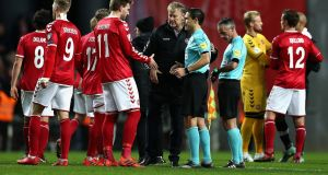 Denmark manager Age Hareide and Danish forward Nicklas Bendtner shake hands with  referee Milorad Mazic at the Parken stadium on Saturday.  Photograph:  Catherine Ivill/Getty Images