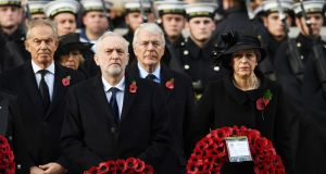 British prime minister Theresa May with Labour leader Jeremy Corbyn during Remembrance Sunday in London. Photograph: Andy Rain/EPA