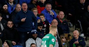 A fan points to his chest as he shouts at West Bromwich Albion's James McClean, who is wearing a shirt without a poppy. Photograph: Reuters