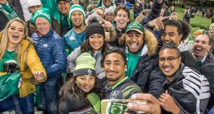 Bundee Aki takes a picture with his  daughter Adrianna Aki and family members. Photograph: Morgan Treacy/Inpho