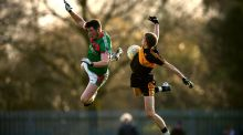 Keelan Sexton of Kilmurry-Ibrickane and Dr Crokes' Gavin O'Shea  contest a high ball during the AIB Munster Club SFC semi-final in Killarney. Photograph: Cathal Noonan/Inpho