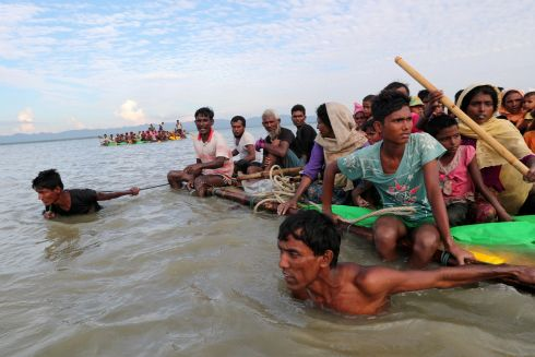 ROHINGYA RAFT: Rohingya refugees pull an improvised raft across the Naf River to reach Teknaf, Bangladesh. Photograph: Mohammad Ponir Hossain/Reuters