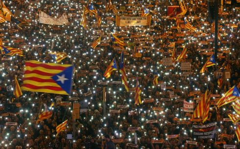 RELEASE URGED: Protesters hold up lights from mobile phones and wave Estelada flags during a rally by pro-independence associations urging the release of jailed Catalan activists and leaders, in Barcelona, Spain. Photograph: Albert Gea/Reuters