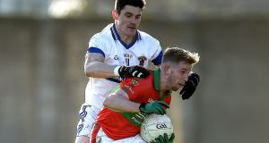 Rathnew's Warren Kavanagh battles with Diarmuid Connolly of St Vincent's during the Leinster club quarter-final in  Aughrim, Co Wicklow. Photograph: Tommy Grealy/Inpho