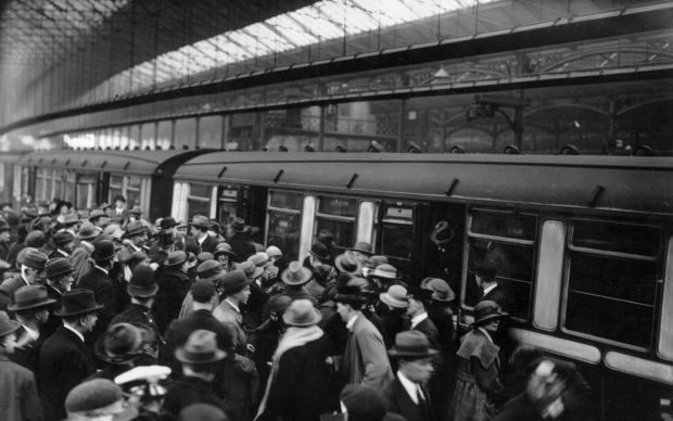 May 1923: Irish people being deported in connection with IRA activities board trains at London's Waterloo station. Photograph: Topical Press Agency/Getty Images