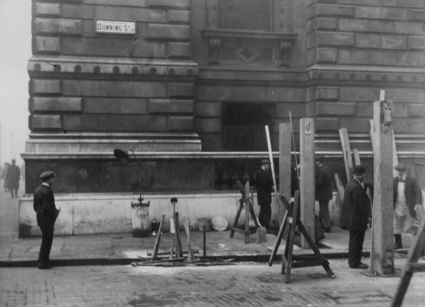 November 1921: workmen construct barricades at the entrance to Downing Street in London as protection against the IRA threat. Photograph: Hulton Archive/Getty Images