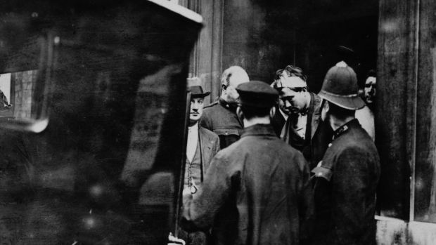 The arrest of Reginald Dunne (with bandaged head) and James Connolly immediately after the assassination in London by the two IRA gunmen of British field marshal Henry Wilson. His assassination helped spark off the Irish Civil War. Photograph: Topical Press Agency/Getty Images