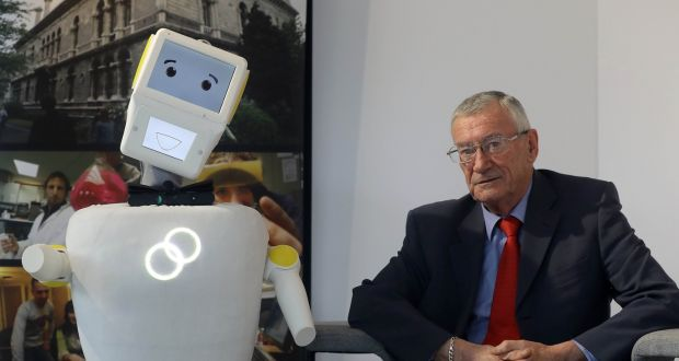 'Stevie' the robot with Test user Tony McCarthy. Photograph: Trinity College Dublin 5