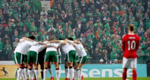 Ireland players during their pre-match huddle ahead of the first leg of their 2018 World Cup qualifying playoff in Copenhagen. Photo: James Crombie/Inpho