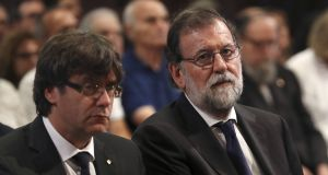 President of Catalonia Carles Puigdemont and Spanish prime minister Mariano Rajoy. File photograph: Sergio Barrenechea/AFP/Getty Image