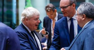 Minister for Foreign Affairs Simon Coveney shakes hands with Britain's foreign secretary Boris Johnson following a European Union foreign ministers' meeting in Brussels. Photograph: Yves Herman/Reuters