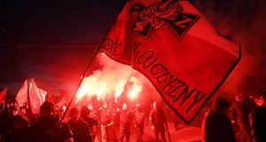 "Polish nationalists carry a flag with the message ""Death to the enemies of the homeland"" as they take part in the march for Polish Independence Day in Warsaw. Photograph: Bartlomie J Zborowski/EPA"
