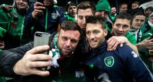 Wes Hoolahan takes a selfie with a fan after the first leg in Copenhagen. Photograph: Ryan Byrne/ Inpho