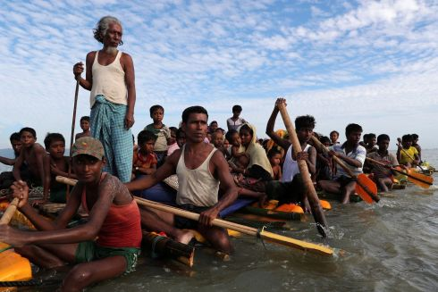 ROHINGYA CRISIS: Rohingya refugees cross the Naf river on an improvised raft to reach Bangladesh. Photograph: Mohammad Ponir Hossain/Reuters