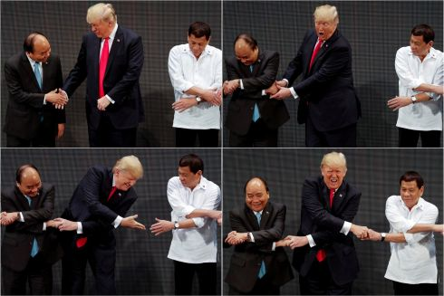 SHOW OF HANDS: Donald Trump reacts as he realises other leaders are partaking in the traditional 'Asean handshake', at the Asean summit in the Philippines. Photograph: Jonathan Ernst/Reuters
