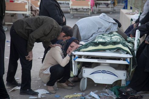 IRAN-IRAQ QUAKE: A woman reacts next to a dead body in Sarpol-e Zahab county in Iran following a quake in the Iran-Iraq border region. Photograph: Tasnim News Agency/Reuters