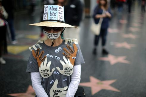 HOLLYWOOD HARASSMENT: A woman wears an outfit with the names of all the men in Hollywood who had sexually harassed her, during a protest march in Los Angeles, US. Photograph: Lucy Nicholson/Reuters