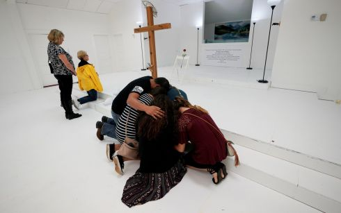 TEXAS MASS SHOOTING: People pray in the First Baptist Church of Sutherland Springs, where 26 people were killed in a shooting attack last week, in Texas, US. Photograph: Rick Wilking/Reuters