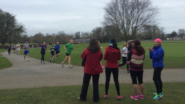 Mary Jennings and others cheering on runners at the Malahide Park Run