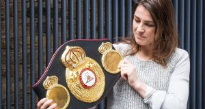 Katie Taylor  with her WBA lightweight belt which she won last month. Photograph: Oisin Keniry/Inpho
