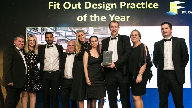 James O'Toole, Fit-out Director, Walls Construction presents the Fit Out Design Practice of the Year award to the MILLIMETRE DESIGN team