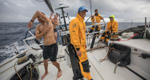 Crew members of Turn the Tide on Plastics take advantage of the rain to have a shower on deck during the second leg of the Volvo Ocean Race from Lisbon to Cape Town. Photograph:  	Sam Greenfield/Volvo Ocean Race