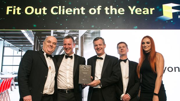 Richard Hemming, MD, StructureTone, presents the Fit Out Client of the Year award to the CRH & Henry J. Lyons teams