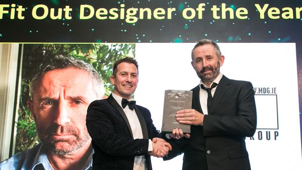 Stephen Pierce, Senior Area Manager, Ireland, Vescom Wallcoverings & Fabrics, presents the Fit Out Designer of the Year award to Barry McCabe, McCabe Design Group.