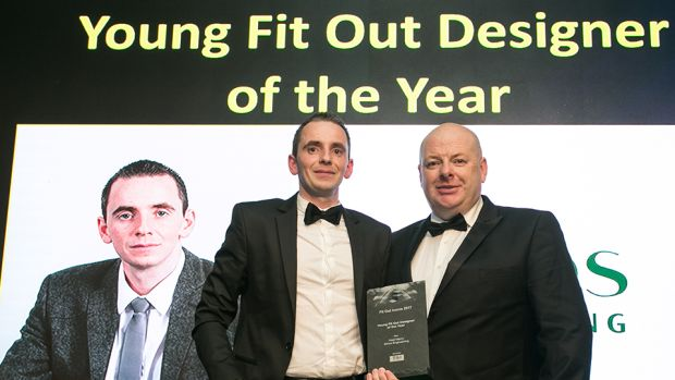 Ben Lambe, Director, T&I Fitouts presents the Young Fit Out Designer of the Year award to Neal Merry, Ethos Engineering
