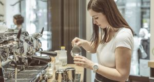 Barista  making a coffee. Photograph: iStock