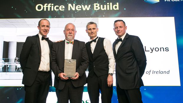 Greg Hayden, MD, Ethos Engineering, presents the Fit Out Project of the Year – Office New Build award to the Central Bank of Ireland Project team