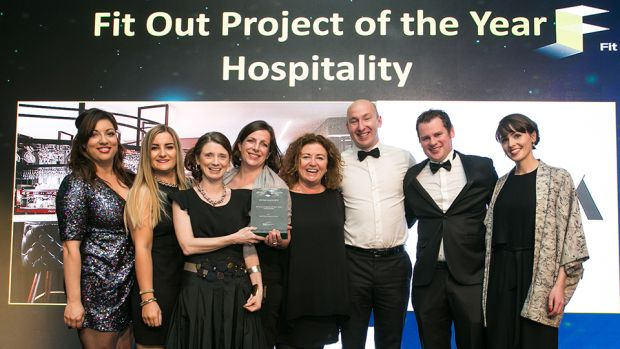 Tomás Mac Eoin, MD, McKeon Group presents the Fit Out Project of the Year - Hospitality award to the NODA Architects team