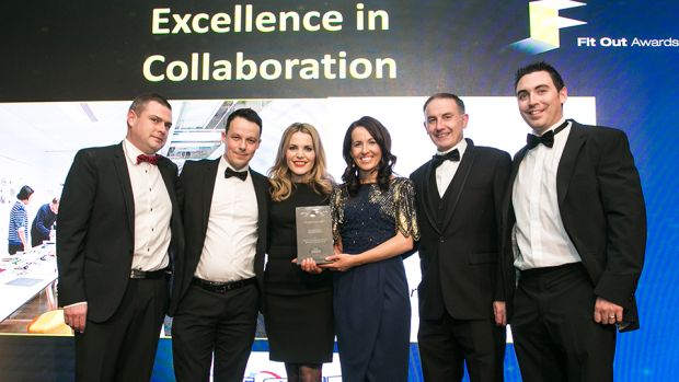 Paul Byrne, Sales Director, Tech Refrigeration & Air Conditioning, presents the Excellence in Collaboration award to the Specialist Joinery Group team