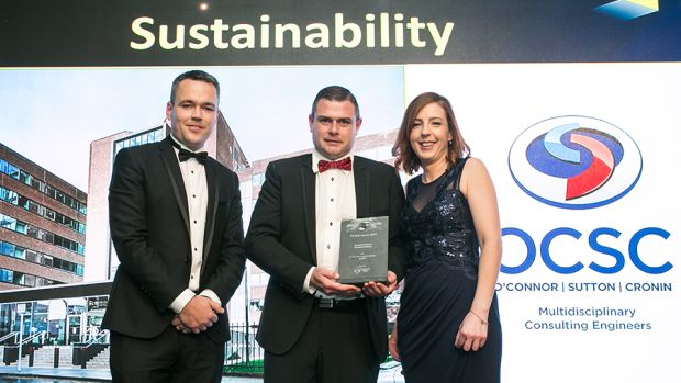 Ciaran O'Hagan, Group Managing Director, Specialist Joinery Group presents the Excellence in Sustainability award to Patrick Field & Patrice McVeigh, O'Connor Sutton Cronin (M&E)