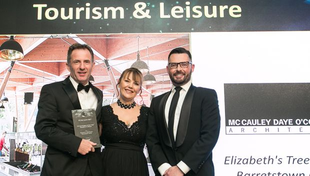 Adele Povey, Area Business Manager Ireland, Nora Flooring Systems presents the Fit-Out Project of the Year – Tourism & Leisure award to Dan Daye & Martin Spillane, McCauley Daye O'Connell Architects