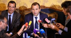 Lebanon's foreign minister, Gebran Bassil, giving a press conference in Paris on Tuesday. He said prime minister Saad Hariri needed to return to Lebanon to prove he was free. Photograph: Lionel Bonaventure/AFP/Getty Images