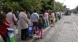 People wait in line to board the Luas bound for Sandyford at St Stephen's Green. Photograph: Moya Nolan
