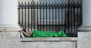 A homeless man sleeps  outside the Custom House: the Dublin Region Homeless Executive spends €96m a year funding 22 non-governmental organisations which provide 88 services to Dublin's homeless. Photograph: Cyril Byrne