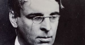 W.B. Yeats wearing his signature glasses.