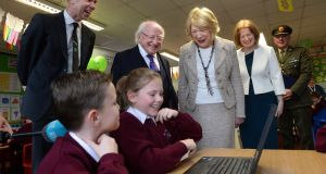 President Michael D Higgins, and his wife, Sabina, with Caitlyn Melia and Jake Anderson, students at St Patrick's national school in Chapelizod, John Fitzsimons of Camara and Edel Gormley, acting principal of the school. Photograph: Dara Mac Dónaill